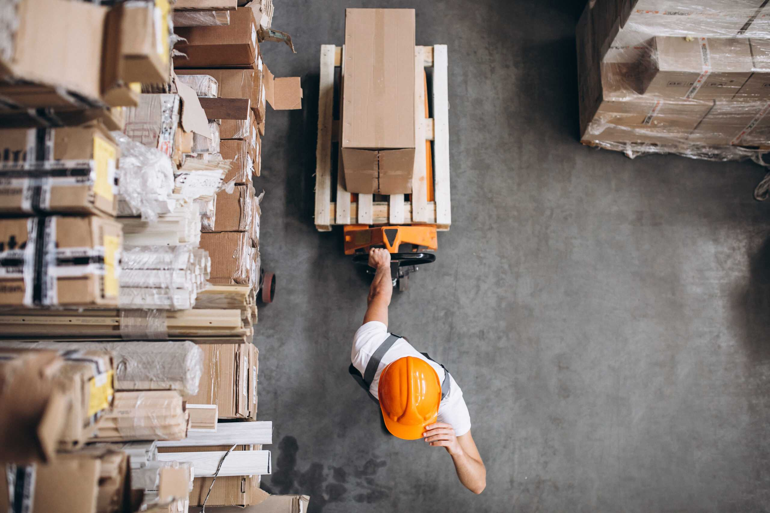 Young man working at a warehouse with boxes